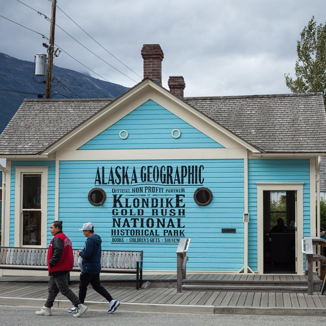 Bright blue building with portholes and a hand painted sign