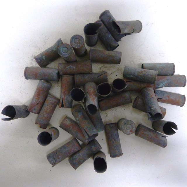 Cluster of metal cartridges on a neutral background