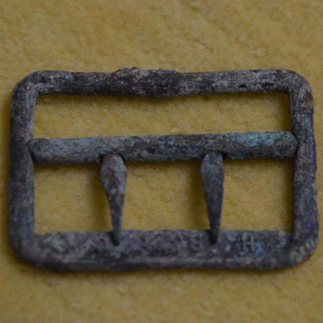 Metal buckle with green corrosion