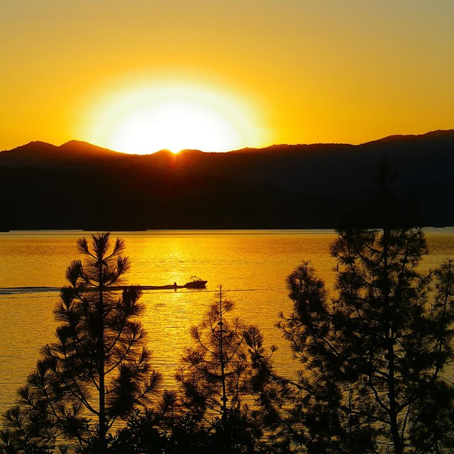 Sunset over boat on Whiskeytown Lake
