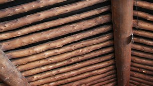 The wooden ceiling of a log cabin