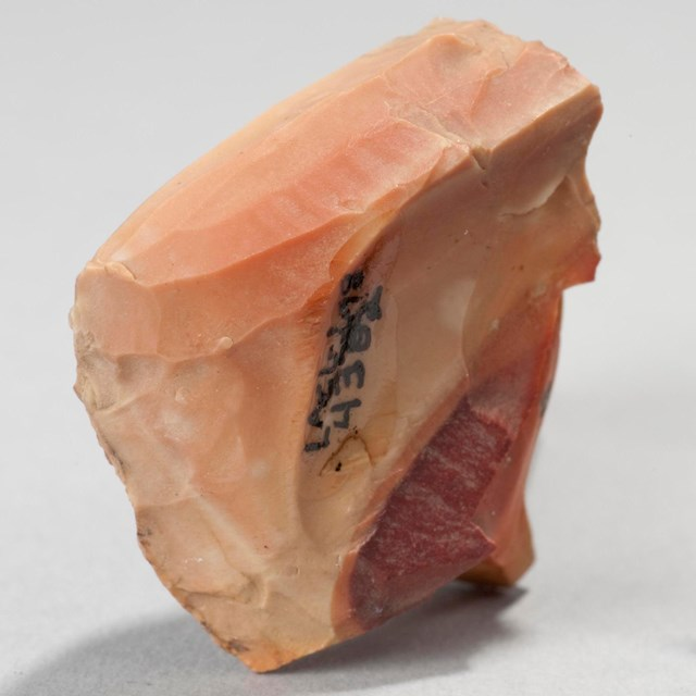 a peach colored microblade core