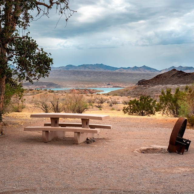 A desert campsite with Lake Mead in the background.