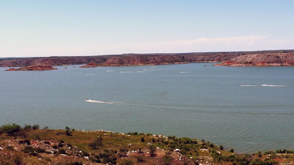 Visitors enjoying boating, water skying, and jet skying on Lake Meredith.