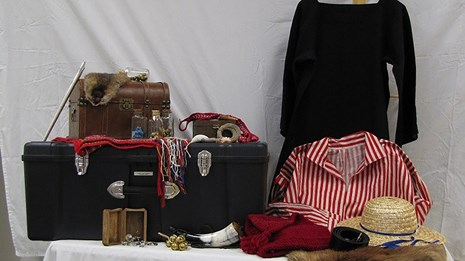 The contents of the David Thompson and the Fur Trade traveling trunk are displayed.