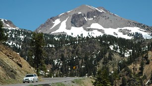 Vehicle on park highway with Lassen Peak in background