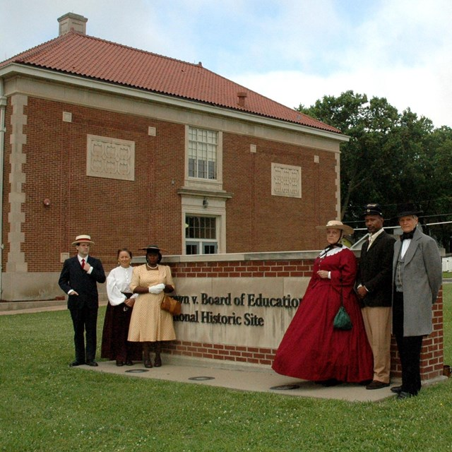 Six reenactors portraying civil rights characters from 1854 to 1954
