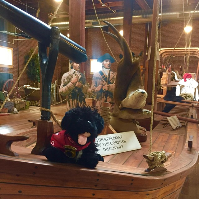 toy dog on keelboat