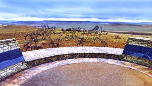 The Memorial is in the shape of a circle. On the inner walls sit panels for each tribe that fought.