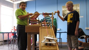 Two boys create a cart at the Tsongas Industrial History Center