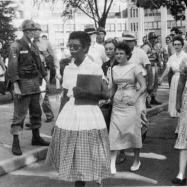 15-year-old Elizabeth Eckford of the Little Rock Nine walking away from Central High School