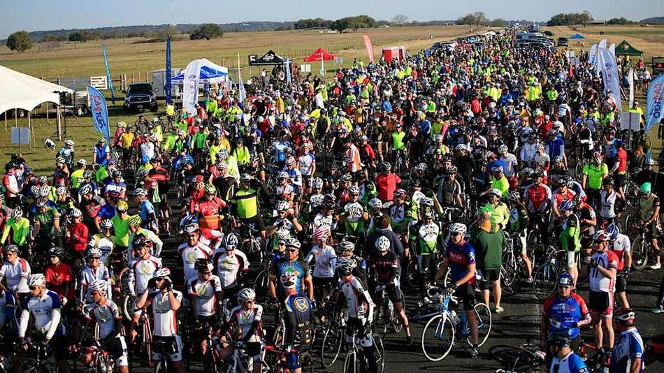 Thousands of cyclists que up at the startline of the LBJ 100 Bike Ride.
