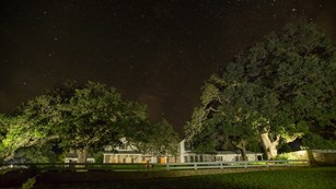 A view of the starry night sky over the Texas White House.