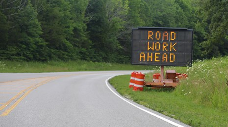 A road work ahead sign