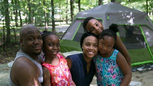 A family enjoys the day in the campground.