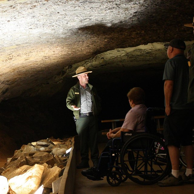 A ranger speaks to visitors with disabilities on the Accessible Tour in Mammoth Cave.