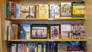 Bookshelf with books about Japanese Incarceration