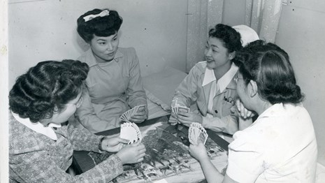 Historic image of four women playing cards