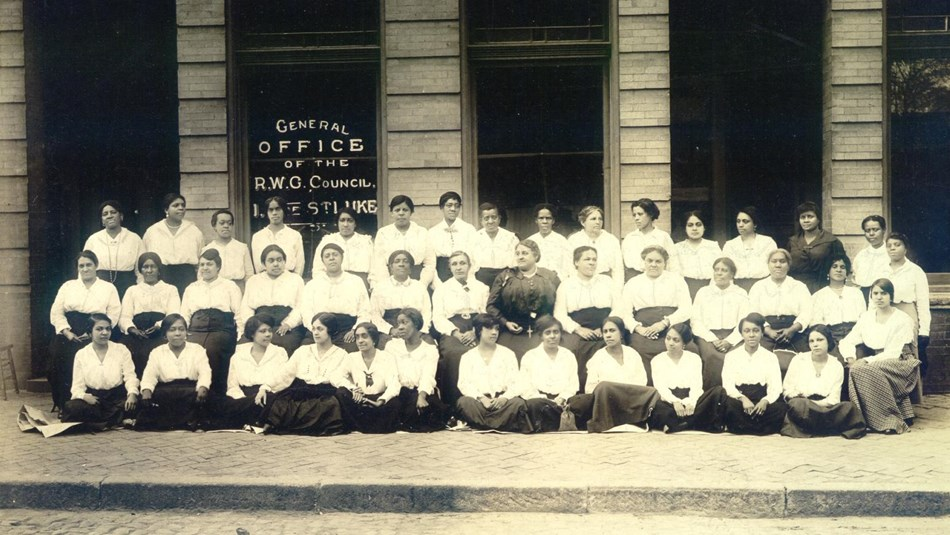 Maggie L. Walker with female St. Luke office staff members in front of St. Luke Hall in 1917