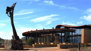 Outdoor welcome plaza at entrance to visitor center.