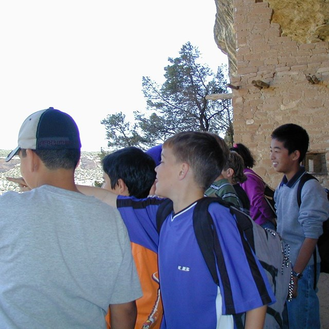 Students visiting a cliff dwelling.