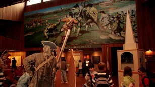 Visitors explore April 19, 1775 exhibits at Minute Man Visitor Center
