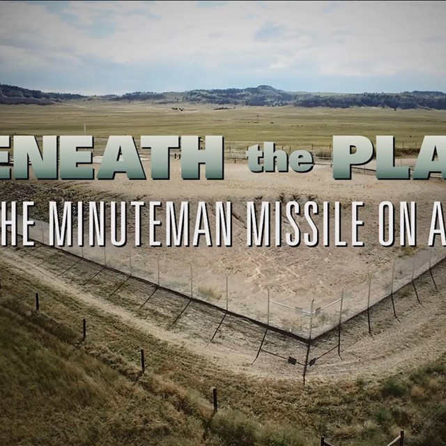 film title over a plains landscape with a missile silo.