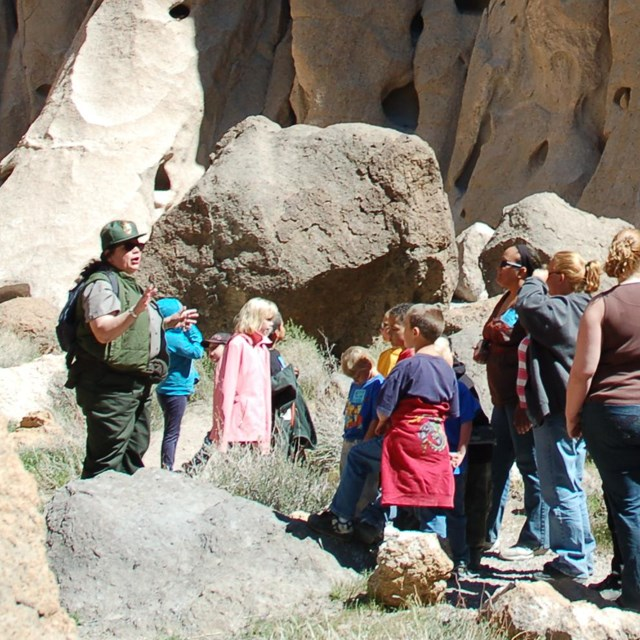 Park ranger leading kids on a tour of the Rings Loop Trail