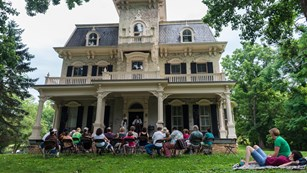 Singers play a concert at the Gambrill Mansion
