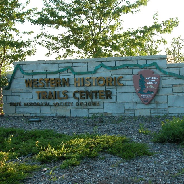A stone entry sign for the Western Historic Trails Center.