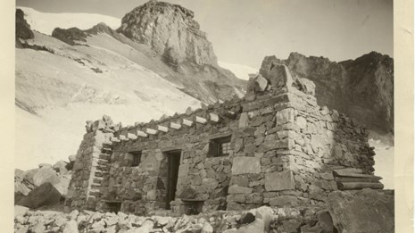 A stone building on a rocky mountainside