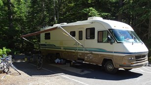 An RV parked at a campsite.