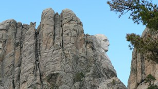 Close up photo of the eyes of Theodore Roosevelt on Mount Rushmore.