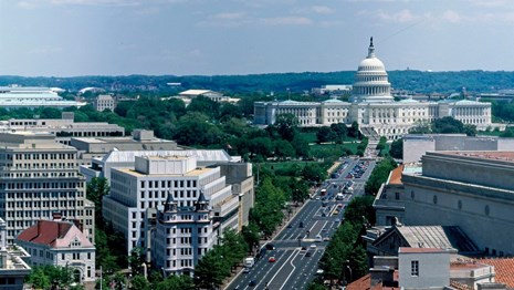 Image of the United States Capitol looking down Pennsylvania Avenue.