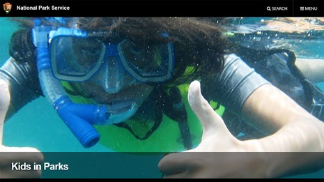 Website screenshot of a young person snorkeling.