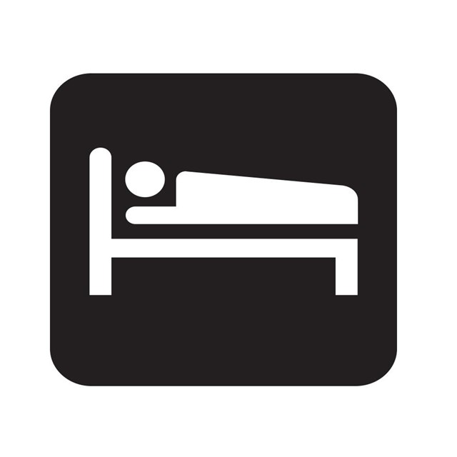 Lodging map symbol with a person sleeping on a bed.