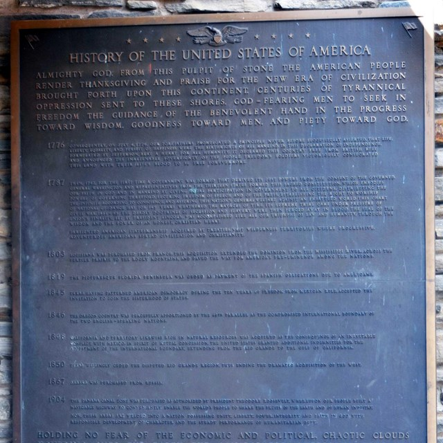 Photo of a plaque inscribed with the winning essay.