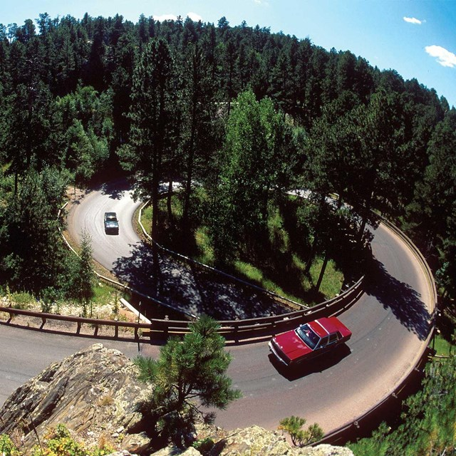 Vehicles traveling on the Iron Mountain Road near Mount Rushmore.