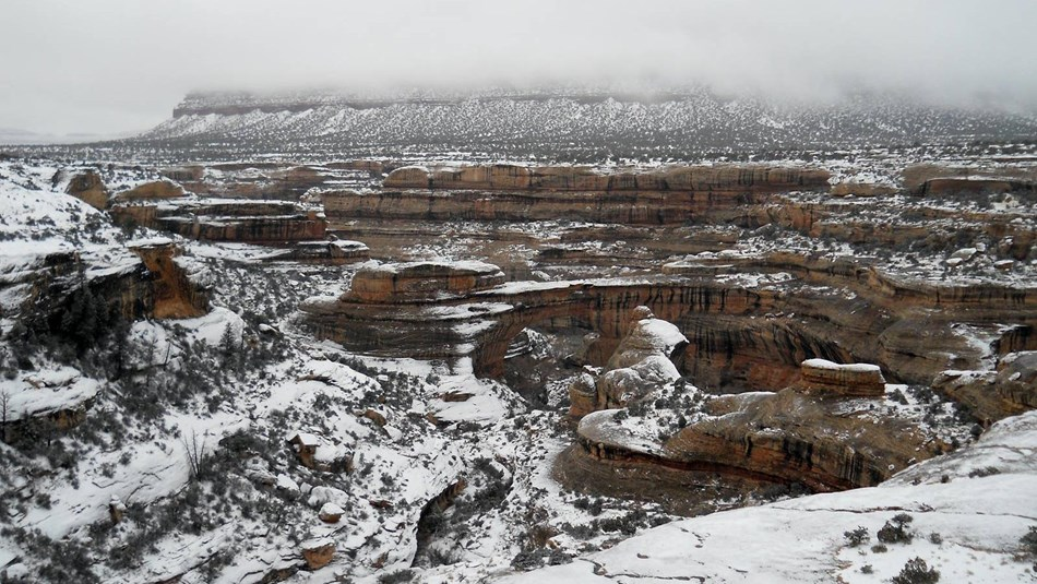 Sipapu natural bridge and surrounding landscape covered in snow