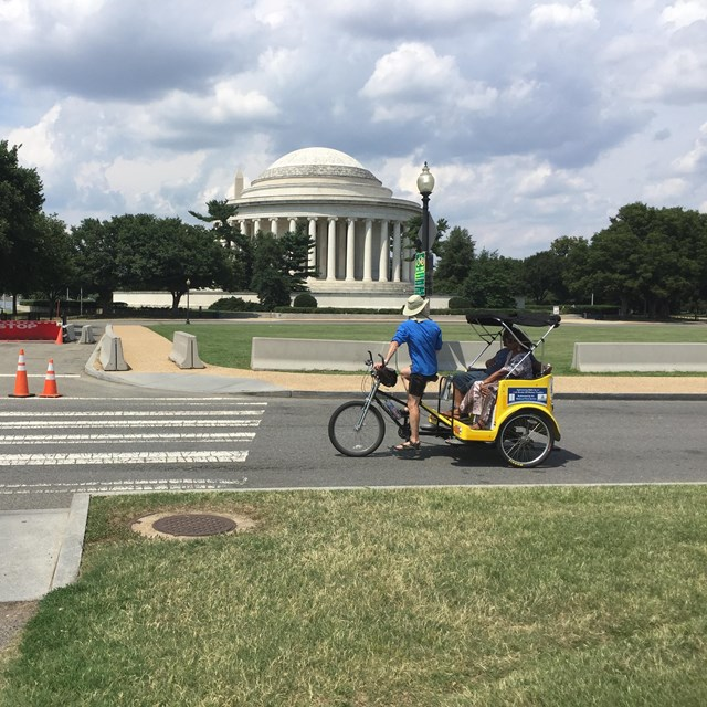 Pedicab on the road in front of the Jefferson Memorial
