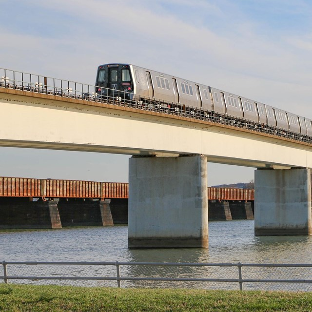 Metro train on a bridge over a river