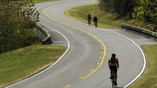 Cyclists pedal through the rolling hills of the parkway.