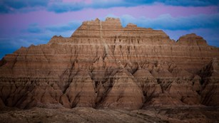 Close up of the badlands in South Dakota with a blue and purple sunset sky