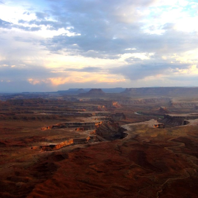 Evening sunlight over vast canyon