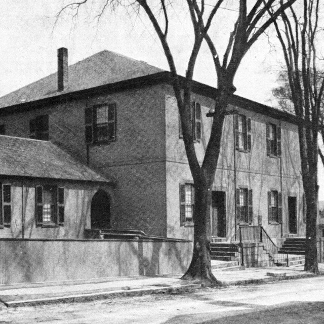 Black-and-white photo of Quaker meetinghouse on Spring Street in New Bedford.