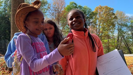 students using an anemometer