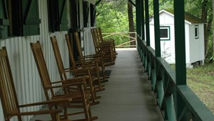 long porch with rocking chairs