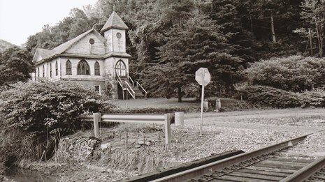 black and white photo of building and RR tracks