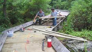 maintenance workers building a boardwalk