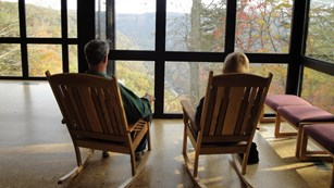 visitors in rocking chairs admire the view